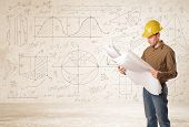 pic of structural engineering  - Handsome engineer calculating with hand drawn background concept - JPG