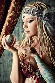 foto of divine  - Magnificent fortune teller holding crystal ball - JPG