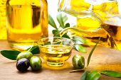 ������, ������: Olive Oil Pouring Virgin Olive Oil in a bowl close up Olives and Healthy Olive oil being poured fr