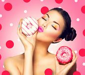 pic of high calorie foods  - Beauty fashion model girl taking sweets and colorful donuts - JPG