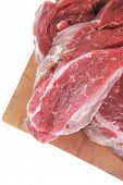 image of porterhouse steak  - fresh raw beef steak entrecote fillet ready to prepare on cut board with cutlery and castor isolated over white background - JPG