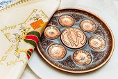 image of passover  - seder plate vor passover holiday and special napkin with embroidery for matze bread knew plate located below - JPG