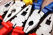 foto of pliers  - Close up Assorted Hand Work Tool Pliers - JPG