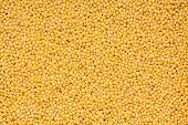 stock photo of millet  - full organic millet seeds as yellow background - JPG