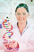 pic of double helix  - Science and medical graphic against portrait of a cute scientist showing the dna double helix model - JPG