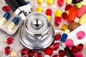 image of ibuprofen  - Picture of a colourful pills capsules and stethoscope - JPG