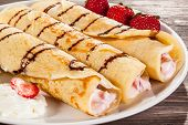stock photo of crepes  - Crepes with strawberries and cream - JPG