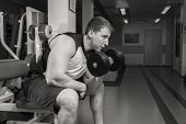 Постер, плакат: Man doing workout with heavy dumbbell