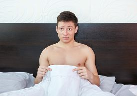 picture of masturbate  - Impotent man worrying about his penis and erection failure Surprised young man having trouble with potency and prostate - JPG