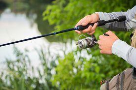 image of rod  - Fishing in river - JPG