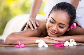 picture of thai massage  - Young woman gets a massage with closed eyes  - JPG