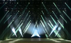 image of soffit  - Illuminated empty concert stage with smoke and rays of light - JPG