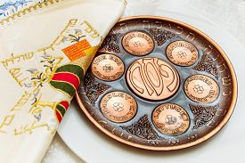 picture of seder  - seder plate vor passover holiday and special napkin with embroidery for matze bread knew plate located below - JPG