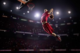 foto of slam  - red Basketball player in action in gym - JPG