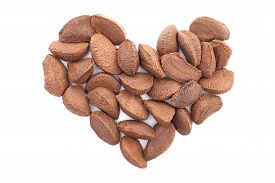 picture of brazil nut  - Brazil nuts in a heart shape isolated on a white background - JPG