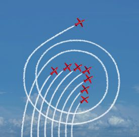 foto of dominate  - Outperform the market business concept as a jet airplane running circles around the competition with engine smoke as a success symbol of rising above and dominating others - JPG