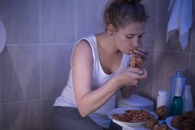 picture of bulimic  - Photo of girl with bulimia can not control her hunger - JPG