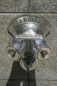 foto of firehose  - Standpipe for fire fighters under sunlight shiny - JPG