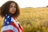 Sad depressed mixed race African American girl teenager female young woman with tears in her eyes in poster
