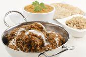 stock photo of tadka  - Goan chicken xacuti drizzled with coconut milk - JPG