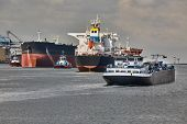 Ship traffic in the busy Port of Rotterdam, large crude oil tanker ship coming into port poster