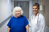 Portrait of mature Caucasian female doctor and senior Caucasian female patient looking at the camera poster
