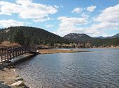 A Wooden Bridge Spans The Evergreen Lake In Evergreen, Colorado. poster