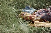 Hippie Woman Lying On Grass Photo With Copy Space. poster