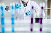 Biochemistry Laboratory Research, Scientist Or Medical In Lab Coat Holding Test Tube With Reagent Wi poster