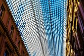 Ceiling Made Of Glass. Transparent Ceiling Made Of Glass. Wired Ceiling Between Two Buildings. poster