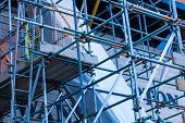 The Steel Scaffold Is Set Up On A Renovated Building. Construction Site With Steel Scaffolds. poster