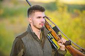 Masculine Hobby Activity. Hunting Season. Man Bearded Hunter With Rifle Nature Background. Experienc poster