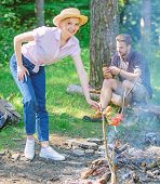 Girl In Straw Hat Cooking Food At Campfire Nature Background. Tips Every Camper Should Know About Ca poster