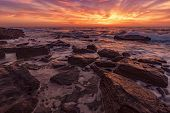 Rocks On The Stone Beach At Sunset. Twilight Sea And Sky. Dramatic Sky And Clouds. Nature Landscape. poster