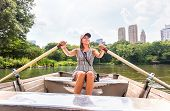 Woman Rowing A Rowboat And Having Fun In Nature. Boating In Summer. Smiling Happy Lady Enjoying Outd poster