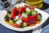 Greek Salad Of Fresh Cucumbers, Tomatoes, Sweet Peppers, Lettuce, Feta Cheese And Olives With Olive  poster