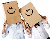 image of incognito  - Couple of cardbord characters with smiley faces  - JPG