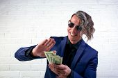 Businessman Throwing Money On White Background. Man In Suit Wear Wasting Money, Throwing Banknotes,  poster