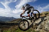 pic of descending  - Rider in action at Freestyle Mountain Bike Session - JPG