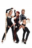 Three dancers in latex bdsm costumes