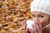 Woman Drinking A Hot Drink In Autumn Or Winter
