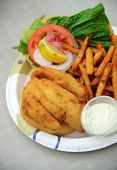pic of hogfish  - fried fish lunch with french fries and tomato