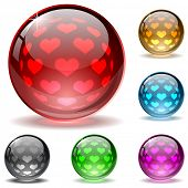 Glossy colorful globes with hearts inner spherical pattern.