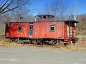 image of caboose  - Old red caboose abandoned on railroad tracks - JPG