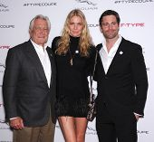 LOS ANGELES - NOV 19:  George Lazenby, Jodie Kidd and David Blakeley arrives to the Jaguar F-TYPE Gl