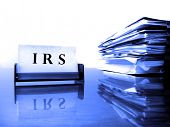 IRS Card on desck with tax files
