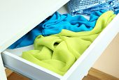 Open drawer with fabrics close up