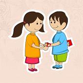 picture of rakhi  - Cute little sister tying rakhi on her brother wrist - JPG