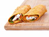 stock photo of sandwich wrap  - Wrap sandwich with feta cheese tomatoes and basil - JPG