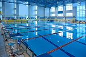 foto of grandstand  - Empty swimming pool for sports competition and fitness exercises - JPG